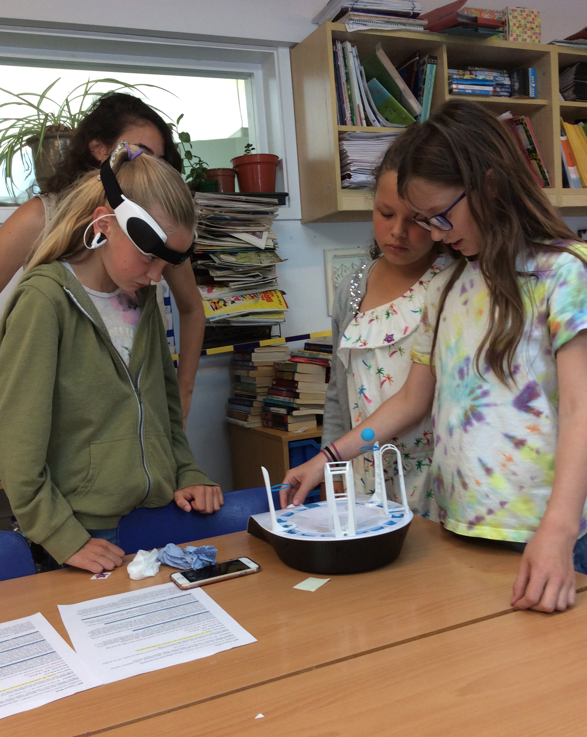 Unit scientist Dr Hayriye Cagnan (back left) encourages pupils to give a live demonstration of their brain power!