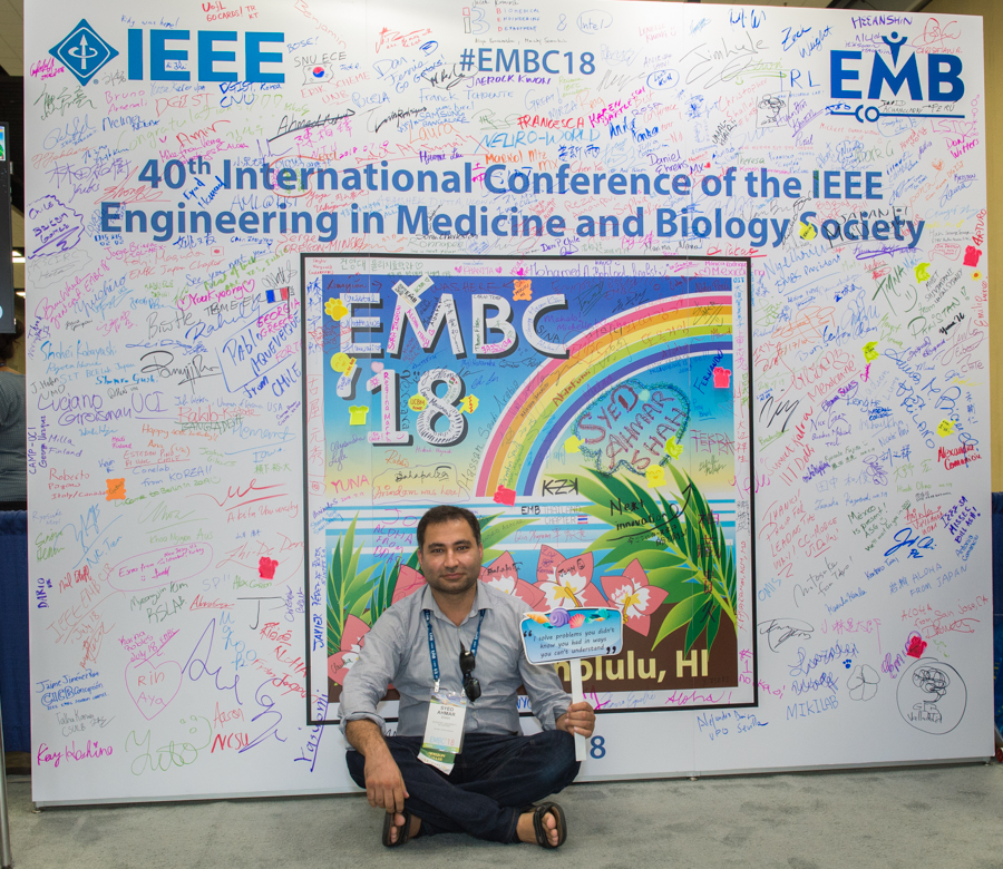 Ahmar takes a moment to rest at the IEEE conference in Hawaii.