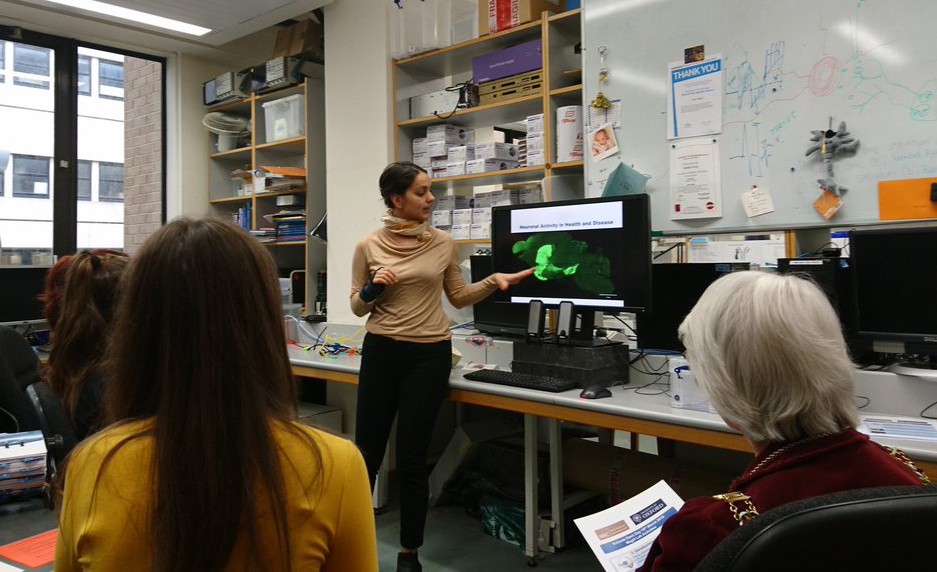 Unit scientist Dr Emilie Syed gives visitors a virtual tour of her research on the electrical activity of nerve cells in the brain.