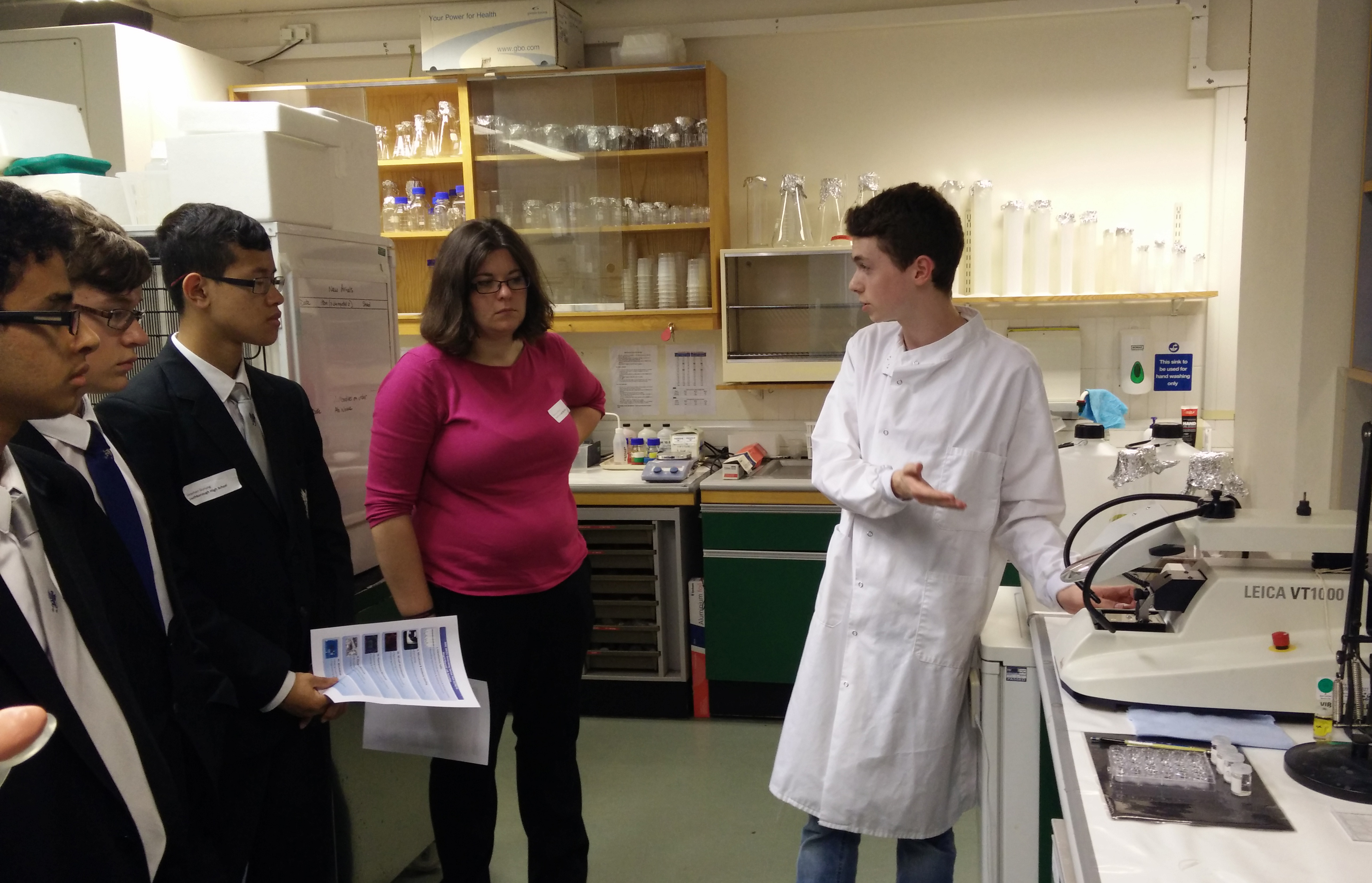 Unit FHS undergraduate student Calum McIntyre shows visiting pupils some of his research on brain structure.