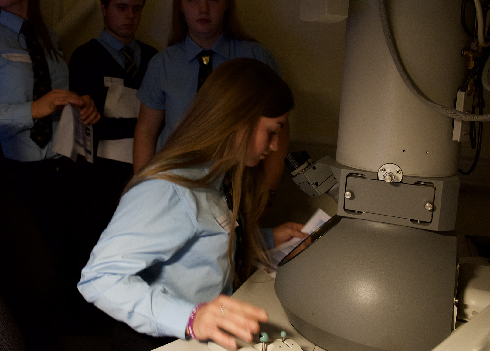 Visiting pupils use the Unit's electron microscope to view the synapses made by nerve cells.